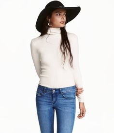 Natural white. Short, fitted turtleneck top in ribbed jersey with long sleeves. $25 at H&M