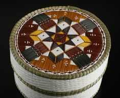 Quill Basket (Geometric design) by Lorraine Besito, Ojibwa (Saugeen) artist. Medium: birch bark, sweet grass, and porcupine quills. Shown at Spirit Wrestler Gallery, Vancouver, BC