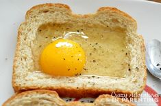 "Combining her love for cheesy eggs with eggs ""over easy,"" try this delicious Cheesy Baked Egg Toast for breakfast. Breakfast Dishes, Breakfast Recipes, Breakfast Ideas, Cheesy Eggs, Egg Toast, Baked Eggs, Perfect Breakfast, Food 52, Cooking Recipes"