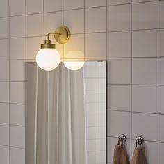 The soft, round shapes and use of metal and glass create a timeless look that resembles lamps of the past. It is approved for bathroom use and is also a good solution for hallways. Modern Bathroom Light Fixtures, Bathroom Wall Lights, Wall Sconces, Wall Lamps, Basement Bathroom, Ikea Bathroom Lighting, Bathroom Ideas, Bathroom Trends, Chic Bathrooms