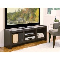 Keep your games, movies, and other appliances secure in this large TV stand with storage. It has four storage spaces that allow you to organize your appliances neatly. The panels can hold a 60-inch TV, and the back panel allows access to wiring.
