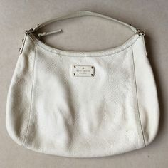 Authentic Kate Spade White Leather Shoulder Bag Preowned and in good condition Authentic Kate Spade White Leather Shoulder Bag. Bag has small dirt stains all around from normal wear. Also some pen marks. Inside there is a black stain. Please look at pictures for better reference. Still, this bag has tons of love to give!! Thank you for looking and happy shopping!! kate spade Bags Shoulder Bags