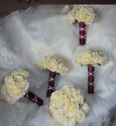 BRIDESMAID's BOUQUET IDEA: Ivory flowers and burgundy ribbon. Pair with solid burgundy dresses for contrast.