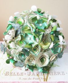 #Emerald green paper flowers and butterflies - via Etsy. A beautiful idea for a #bouquet!