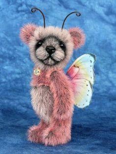 Teddy Valley Bears: Miniature butterfly panda bear on flower