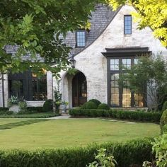 Get the whitewashed brick look! We're talking limewash, German Smear, slurry wash, and paint to show you the ways to get this favorite exterior update. Tudor Exterior Paint, Tudor House Exterior, Cottage Exterior, Modern Farmhouse Exterior, Exterior Paint Colors, Exterior Design, White Wash Brick Exterior, Building Exterior, House Building