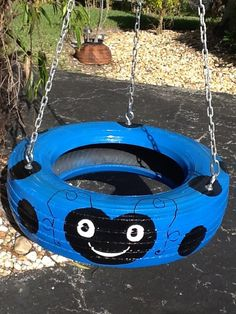Red ladybug hand painted Tire Swing. Drainage by Tireswingscom