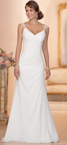 - Figure-flattering asymmetrical ruching throughout bodice and hip - Pleated bodice - Zipper concealed under a band of Chiffon - Lace shoulder straps - Simple yet elegant A-line style that is great fo