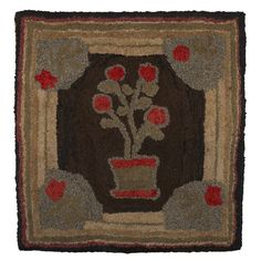 EARLY AMERICAN HOOKED RUG WITH FLOWER POT AND RED ROSES.  Now mounted on a stretcher, 36 ½ x 34 ¾ inches.