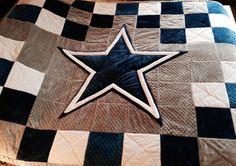 A one of a kind Dallas Cowboys quilt, created by Minky Design & Such.