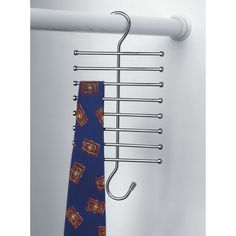 Organize your closet in an instant with Spectrum's Tie & Belt Rack. Ideal for storing ties, belts, scarves and more, its clever design features two rows of . Closet Accessories, Diy Fire Pit, Closet Storage, Belt Tying, Chrome Finish, Home Organization, Clothes Hanger, Magazine Rack, Gift Shops