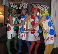 Homemade Twister Group Halloween Costume: We created a homemade Twister group Halloween costume, one person in each color of the game.  We each purchased one board game.  We took the actual flimsy