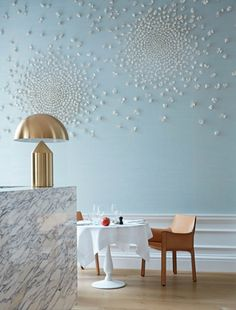 The interiors of Skye Gyngell's new London restaurant Spring: Spring's interior sees diners seated in Mario Bellini for Cassina '412 Cab' chairs, available from Cult, while a classic Vico Magistretti for Oluce 'Atollo 233' table lamp, available from Euroluce, decorates one corner of the Arabescato Corchia marble bar.