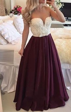 Sexy Burgundy Long Plus Size Prom Dress With PearlsWant a glamorous red carpet look for a fraction of the price? This exquisite dress would be perfect as a bridesmaid dress or to wear to a prom. Ideal..
