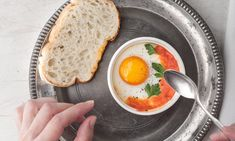 In this classic French technique, eggs are cracked into individual ramekins and baked in a water bath, and always achieve runny-yolk perfection. Oeufs e... Breakfast Items, Breakfast For Dinner, Breakfast Dishes, Breakfast Recipes, Egg Recipes, Brunch Recipes, Cooking Recipes, Brunch Ideas, Cooking Tips