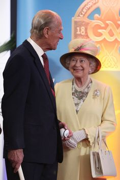 Queen Elizabeth II's Historic Visit To Ireland - I love the way she's looking at her husband