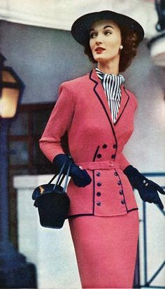 Evelyn Tripp looking super chic in dark carnation pink and navy blue, 1952.