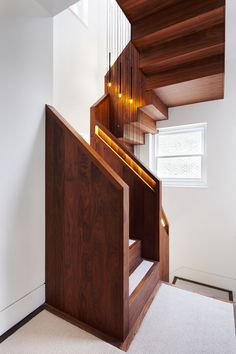 Staircase inside a west London house extension featuring a window that stretches up to the roof.