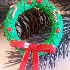 Christmas Wreath. www.teeliesfairygarden.com . . . Bring home this fairy garden handmade Christmas wreath to your garden today! With the lovely berries and the sweet candy cane, the fairies are going would be glad to hang it in their doors! #fairywreath