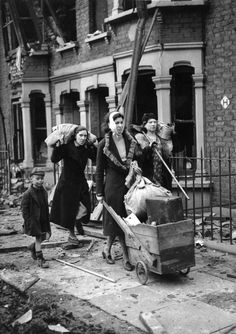"East Londoners are made homeless during German air raids on London. (Photo by Fred Ramage/Keystone/Getty Images). Circa 1940 (via London During The Blitz) - ""The Blitz (from German, ""Lightning"") was the sustained strategic bombing of Britain by Nazi. Old Pictures, Old Photos, Vintage Photos, Famous Photos, London History, British History, Photos Originales, Air Raid, Battle Of Britain"