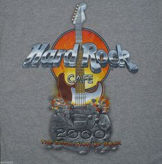 Hard Rock Cafe St. Thomas T-Shirt - Size Small.  This shirt from the Hard Rock Cafe in St. Thomas, Virgin Island features large graphics on the back including a guitar and the words Hard Rock Cafe, The Evolution of Rock and small graphics on the front, left chest.  Great gift for the rock & roll music lover!
