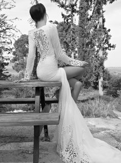 I Love this so much! from the sleeves to the slit to the lace and see through back... so beautiful, so me!