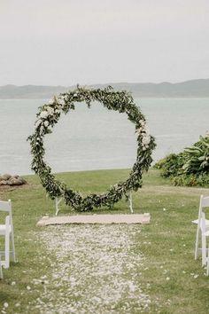 circular greenery ceremony wedding arch #wedding #weddingdecor #weddingarches #weddingideas