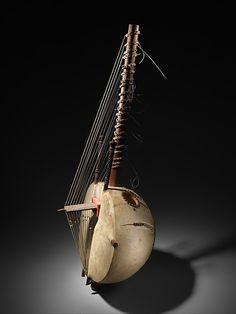 Kora Maker: Mamadou Koyate (bridge by Djimo Koyate) Date: ca. 1960 Geography: Senegal Culture: Mandinka people, Senegambia Medium: Gourd, goat skin, antelope-hide metal, wood