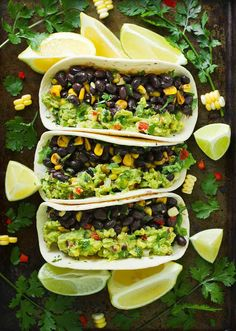 Veggie-loaded guacamole tacos with black beans, corn, and peppers. Vegetarian, vegan, and full-on yummy. Recipe at SoupAddict.com