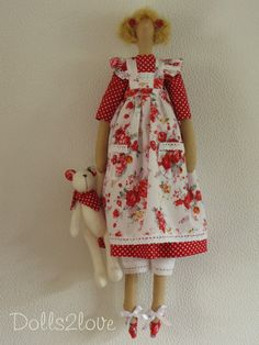 Tilda doll Melody wearing a red polka dot fabric by Dolls2love