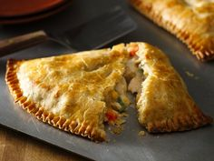 Easy Weeknight Chicken Pot Pie Turnovers - Baked Pillsbury pie crusts stuffed with Green Giant veggies, Betty Crocker potatoes and Progresso Recipe Starters mushroom cooking sauce gives you delicious pot pie  perfect for dinner.