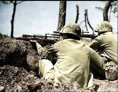 Springfield M1903 sniper rifles.  USMC on Okinawa.l