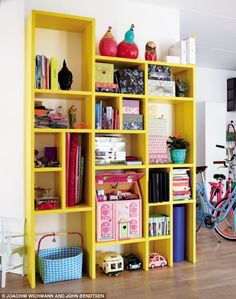 bright yellow bookshelf. ikea hackers, can i make this from Ivar system?