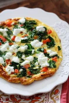 This Kale, Red Pepper and Goat Cheese Frittata is a light vegetarian option perfect for breakfast, lunch or dinner. Filled with protein and veggies!