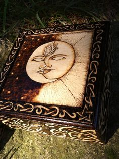 Jewelry box, wood burned (pyrography) with a Sun/Moon design, and celtic knotwork along the sides and edges.