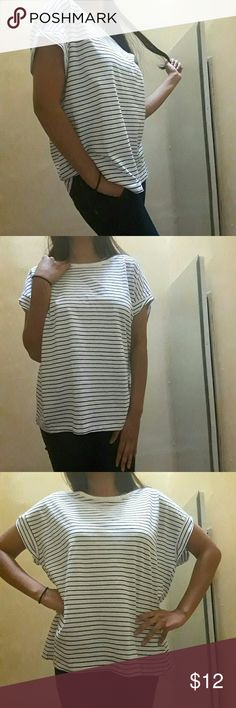 "Zara  black-and-white striped loose fitted tee ♡NTW ♡100% cotton  ♡Color: black and white ♡Season: summer  ♡ boyfriend tee   ♡Length: ~26"" ♡ Sleeves:~3/4"" ♡underarm to underarm: ~25.5""  ♡Due to studio lighting, product be may lighter or darker in pictures. A9 Zara Tops Tees - Short Sleeve"