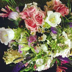 Amanda's Bouquet // These flowers were held by Outward Bound staffers in Leadville last summer.   #breckweddings #breck #breckenridge #wedding #florist #flowers #floraldesign  Photo by Stacy Sanchez