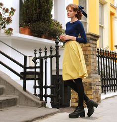 Get this look: http://lb.nu/look/6513320  More looks by Cosette Munch: http://lb.nu/user/168381-Cosette-M  Items in this look:  Yellow Skirt, Second Hand Blue Sweater, Black Boots