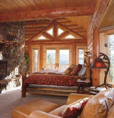 Bedroom in a rustic log home...