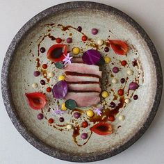 Honey Lavender Duck • Lemon • Chilli • Red Cabbage purée • Onion petals • Duck peppercorn sauce • Wild raspberry fluid gel ____ Info: * Chef: @alvinssto * © Chefs / Submit #GourmetArtistry * Follow us for daily food plating inspiration @gourmetartistry ____