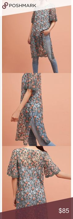 New blue embroidered tunic Beautiful tonic, please look at flowers and let me know if you need measurements, from pet free and smoke free home. New with tag Anthropologie Tops Tunics