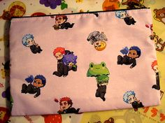 """9""""x6"""" zippered pouch featuring the members of Miracle Generation + Kagami from Kuroko's Basket. Perfect for use as a cosmetic bag or pencil bag. There is also an inner pocket for miscellaneous items."""