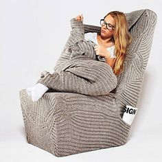 Polish fashion and interior designer Aga Brzostek has created a chair with an integrated blanket for wrapping up warm in winter.
