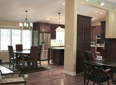 Mahogany kitchen cabinets.  Dark wood, light walls, black fixtures.