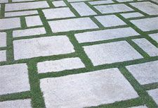 There isn't much we love more than the look of mossy grass (grassy moss? Creating a grid for stonework in a path, yard or driveway is so elegant, chic and clean Permeable Driveway, Stone Driveway, Paver Walkway, Driveway Landscaping, Brick Pavers, Modern Landscaping, Outdoor Landscaping, Driveway Ideas, Driveways