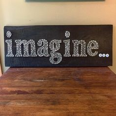 """This """"imagine"""" string art is hand strung on 1 inch thick aged wood. We can do any words or states you want and more! We now sell on Etsy and can ship anywhere in the U.S."""