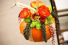Use burlap ribbon for tables at reception? Would be cute for the flower girl to carry filled with autumn leaves,not a real one of course! Or could hang on shepherd's hook outside or free standing wreath hangers in a church! Pumpkin Arrangements, Fall Floral Arrangements, Wedding Flower Arrangements, Outside Decorations, Fall Wedding Decorations, Flower Decorations, Fall Wedding Flowers, Fall Flowers, Autumn Wedding