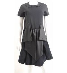 This dress from Marc Jacobs can be worn as work wear with edge, with the statement detail at the front which looks origami-inspired. Style with a cropped blazer and pointed heels for an alternative work wear look.Key features: Peter pan sewn in collar.Short