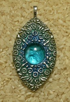 Aqua Magic polymer clay pendant with glass gem by Sweet2Spicy, via Flickr
