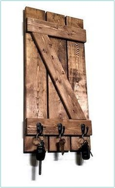 Wood Projects Renewed Décor's miniature shutter key rack features a decorative handmade z-bar style board-n-batten shutter and is built with reclaimed styled solid knotty pine. This key rack is attractive as a deco